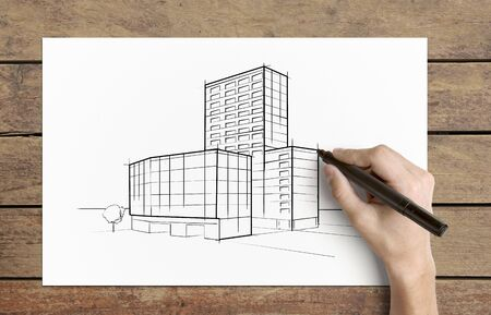 Hand drawing  skyscraper  on  piece of paper Stock Photo - 15149738