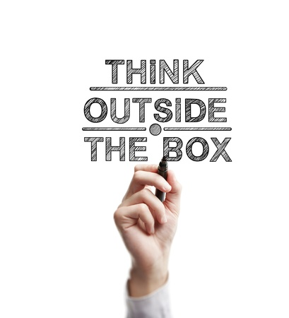 outside the box: man hand draws think outside the box