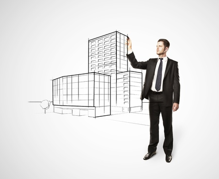 businessman drawing skyscraper on white background photo