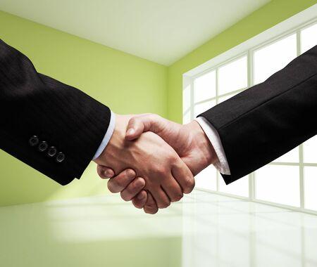 trust people: business handshake in green room
