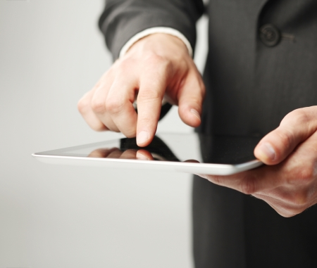 tablet pc in hand: businessman holding digital tablet, closeup