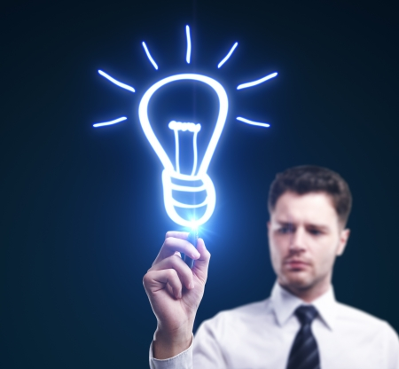 man drawing lamp, idea concept Stock Photo - 15260690