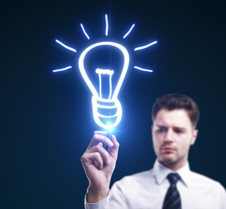 man drawing lamp, idea concept Stock Photo - 15260690