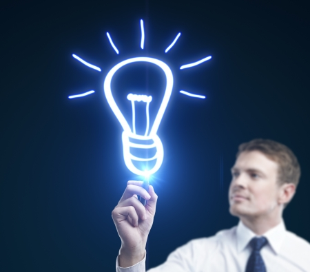 businessman drawing lamp, idea concept Stock Photo - 15260691