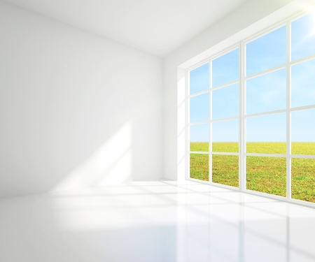 gray room with a view of field from window photo