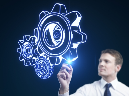 man drawing gears on a blue background Stock Photo - 15260699