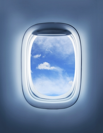clouds in the aircrafts porthole photo