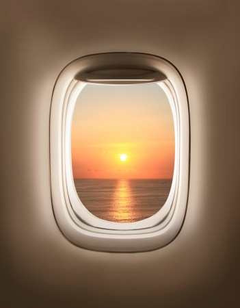 water jet: sunset in the aircrafts porthole Stock Photo