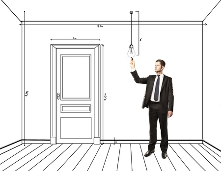 man drawing abstract plan interior photo
