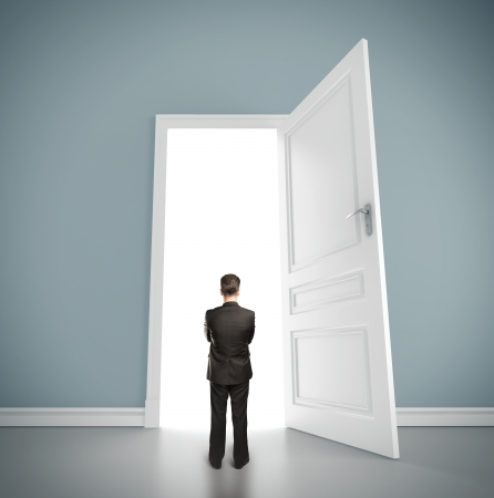 new thinking: businessman in blue room with doors open