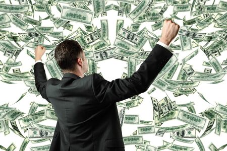 successful businessman and money rain photo
