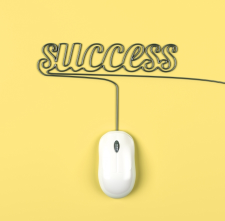 mouse and cables in form of success on a yellow background photo