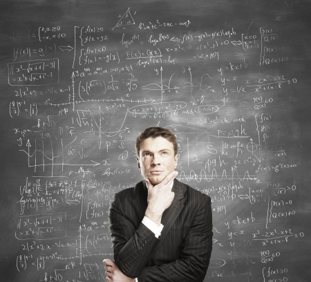 mathematical proof: man on background of board with formulas Stock Photo