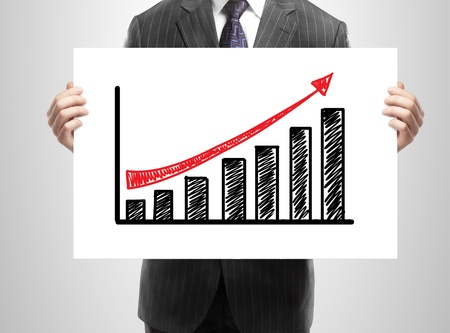 thumbnail: businessman holding a chart of growth