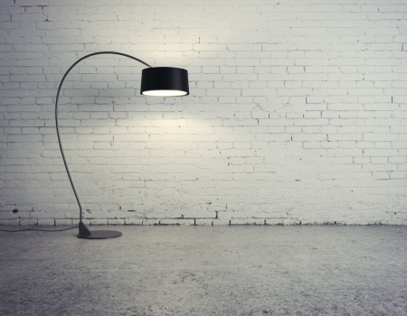 cracked concrete frame: floor lamp in brick room