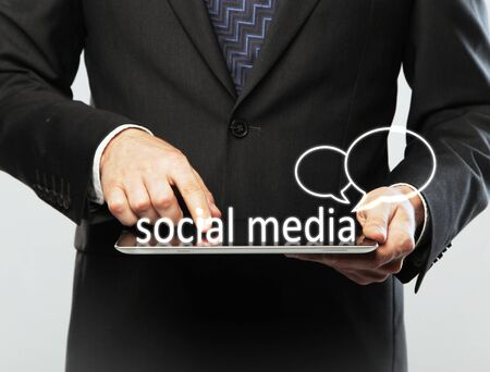 digital table in hand, social media concept photo