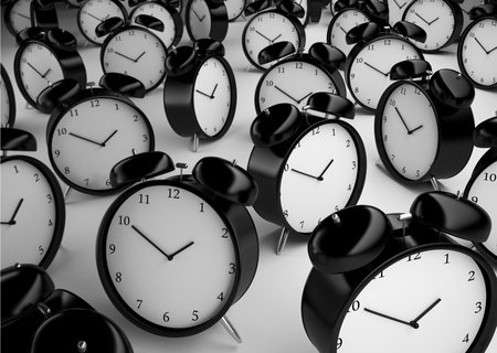 beat the clock: many alarm clock  on a gray background Stock Photo