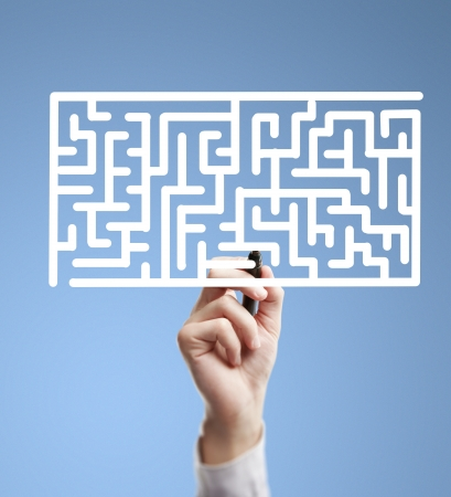 making decision: hand drawing labyrinth on a blue background Stock Photo