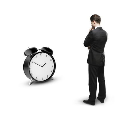 man confused: thoughtful businessman and alarm clock