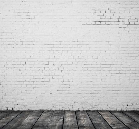 れんが造りの壁とフローリングの床 写真素材