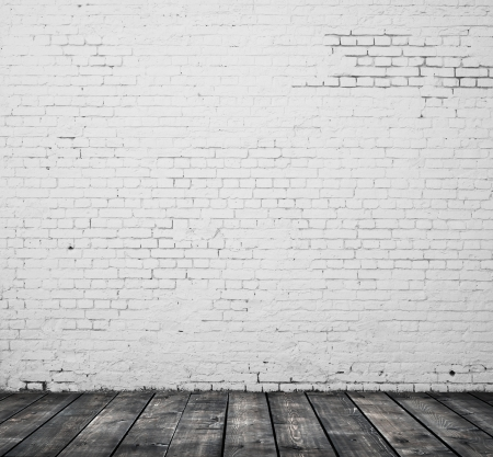 grey abstract background: brick wall and wooden floor