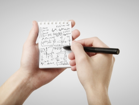 science text: hand drawing formula  in note Stock Photo