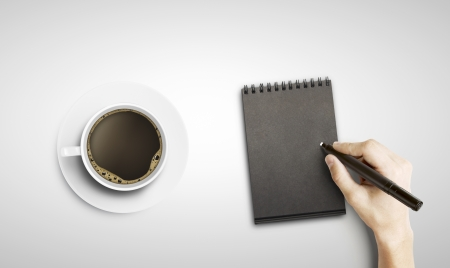 hand drawing in notepad and cup of coffee photo