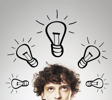 ideas problems: young man with bulbs, idea concept Stock Photo