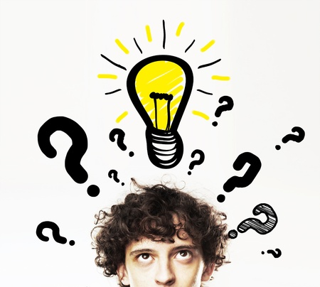 man with lamp and question symbol photo