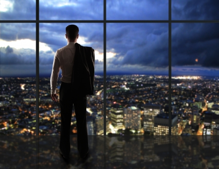businessman thought and city nightlife photo