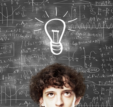 man with lamp and mathematical  formulas photo