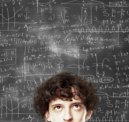mathematical symbol: thinking man against desk with formulas