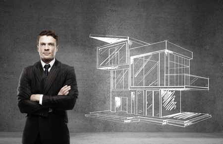 modern house sketch: businessman and drawing cottage on wall