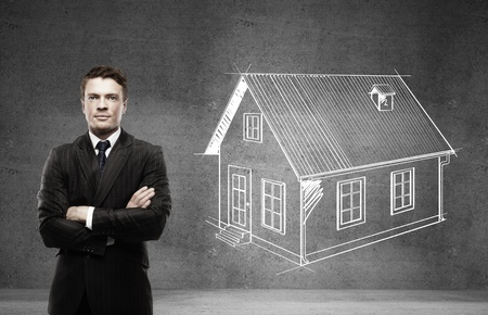 businessman and drawing house on wall photo