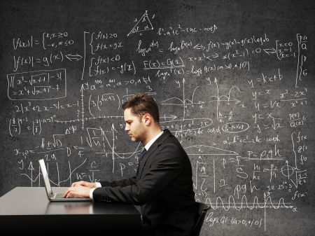 mathematical proof: businessman on a background of formulas