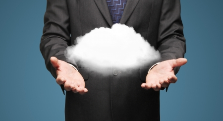 cloud: businessman holding cloud  on a blue background