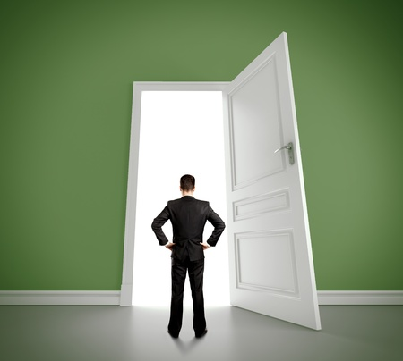 open doors: man in green room with doors open Stock Photo