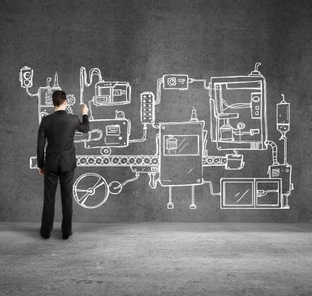imaginacion: Dibujo de hombre de negocios plan de mecanismo en la pared