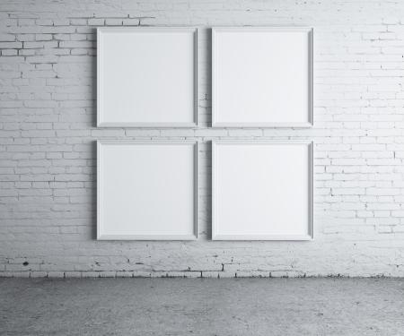 cuatro elementos: cuatro marco en blanco en una pared de hormig�n