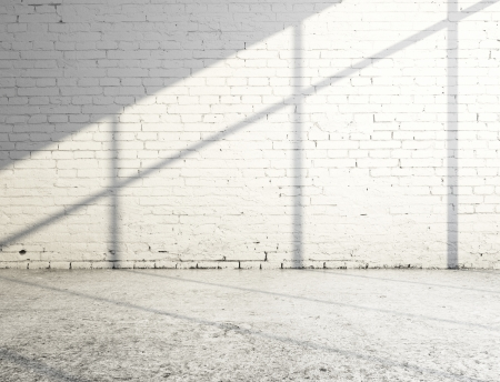 cracked concrete frame: white brick room and sunlight Stock Photo