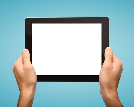 digital tablet in hands on a blue background photo