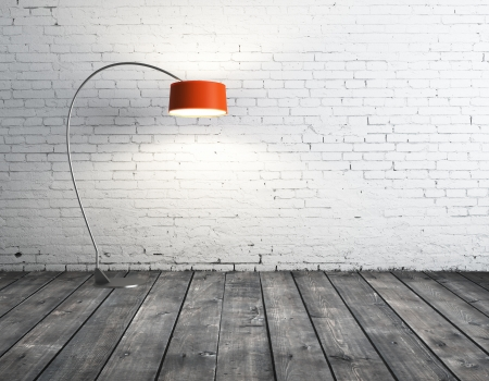orange floor lamp in brick room Stock Photo