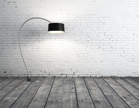 cement floor: floor lamp in brick room