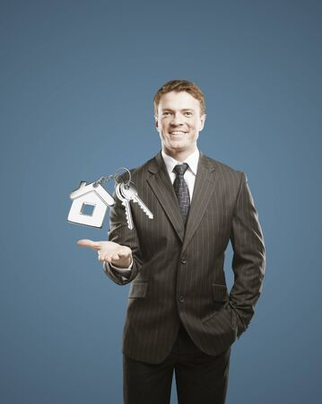 man holding keychain with key in hand Stock Photo - 16119340