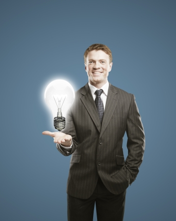 businessman holding lightbulb in hand Stock Photo - 16119339