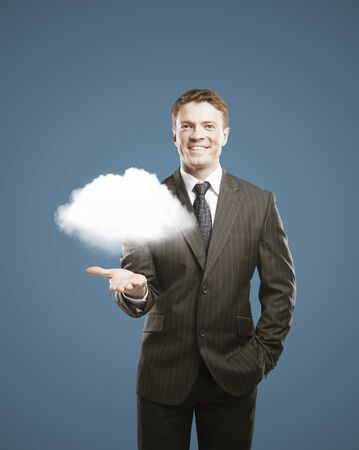 businessman holding cloud in hand Stock Photo - 16119338