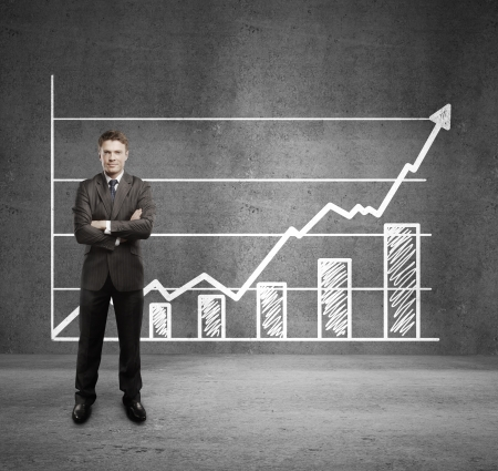 businessman and  growth chart on wall photo