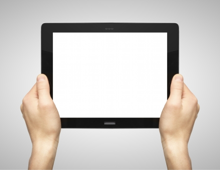 computer tablet: hands holding tablet on grey background Stock Photo