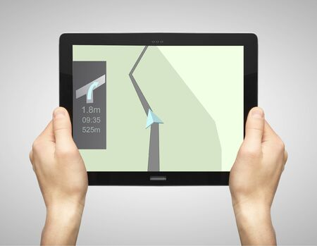 hand holding tablet with drawing map photo