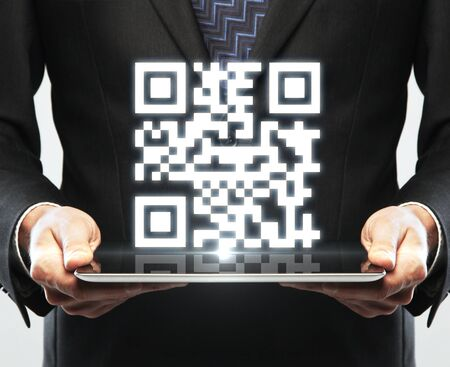 qr: hands hold tablet with interface qr code